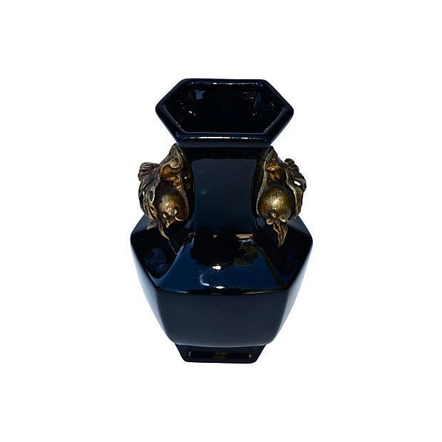 A gorgeous and rare, antique Chinese black porcelain vase with two bronze pomegranate handles, beautifully designed. No...