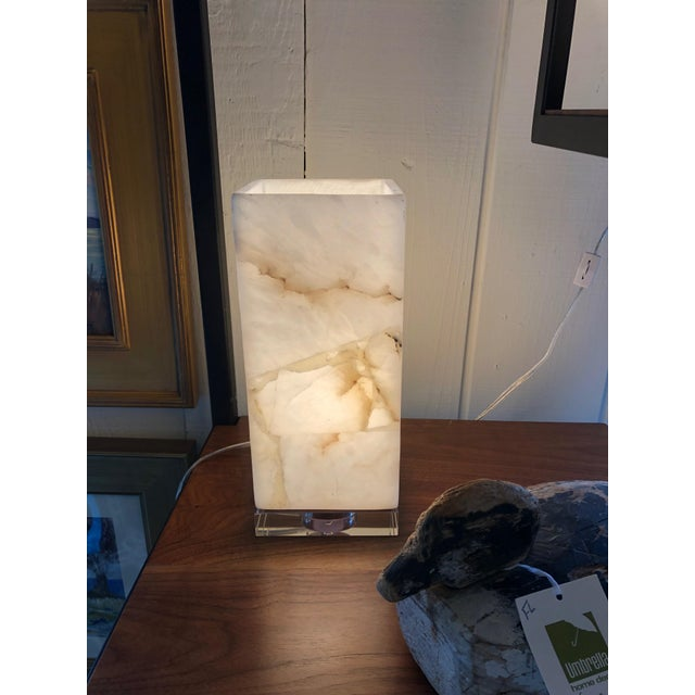Chic pair of marble and lucite columnar cube shaped table lamps.