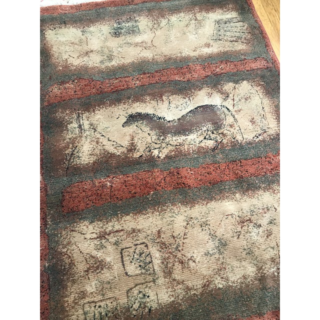Rug designs echoing the Paleolithic cave drawings discovered in Grotte de Lascaux caves above the Vezere Valley in...