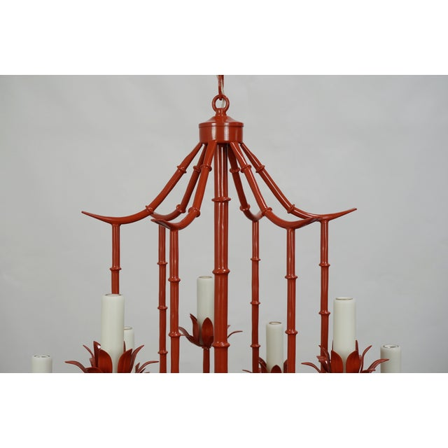 Nine light coral colored faux bamboo pagoda chandelier. Newly rewired and refinished, this vintage chandelier has a fresh...