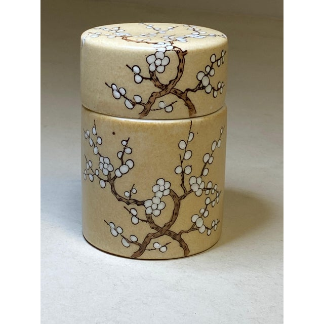 A vintage hand painted for Neiman Marcus in Hong Kong lidded storage box. Beige with tree design.