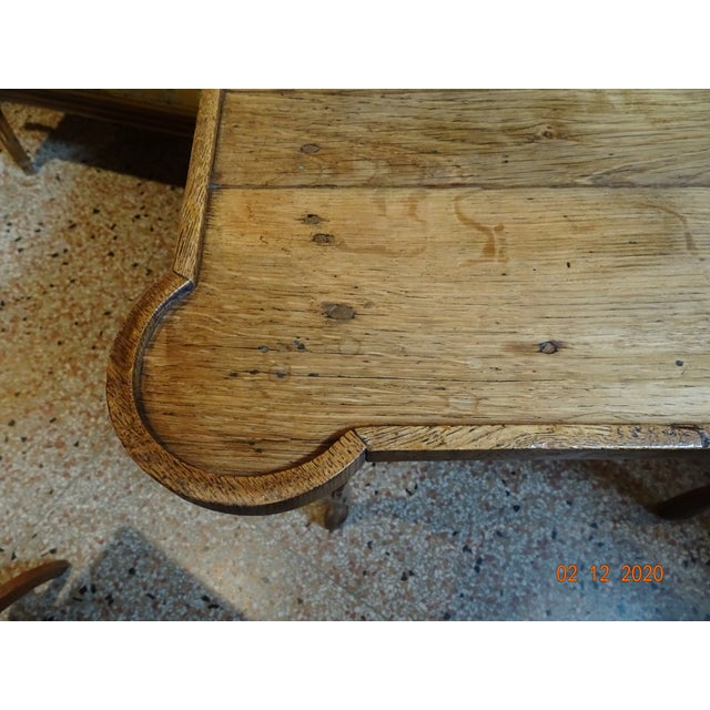 Charming oak French side table with rounded corners, cabriole legs and scalloped apron. Top is made of four planks of...