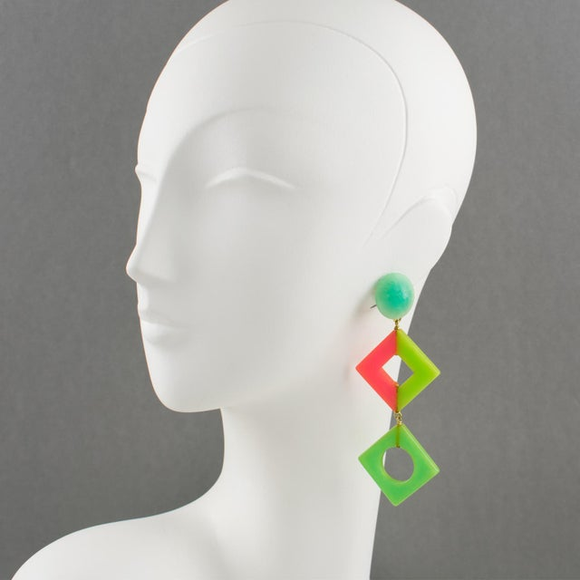 Charming oversized Bakelite dangling clip on earrings in Pop Art design style. Chandelier shape with geometric design...