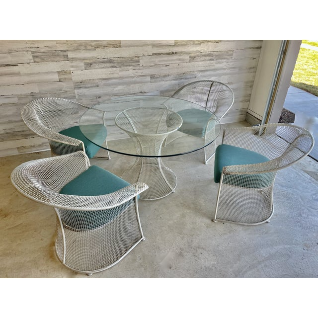 Mid century wire formed patio set / dining set in the style of Russell Woodard. Newly reupholstered in a teal sunbrella...