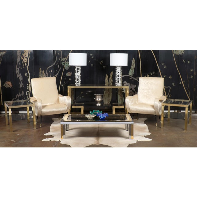 Fantastic Mid-Century Modern period Italian coffee table in chrome, brass, and black glass with gold trim, all original,...