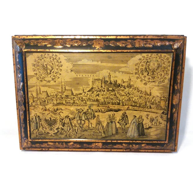 A beautiful Large Antique Biscuit Tin featuring Medieval Scenes by E. Otto Schmidt from Nuremberg, Germany. Schmidt has...