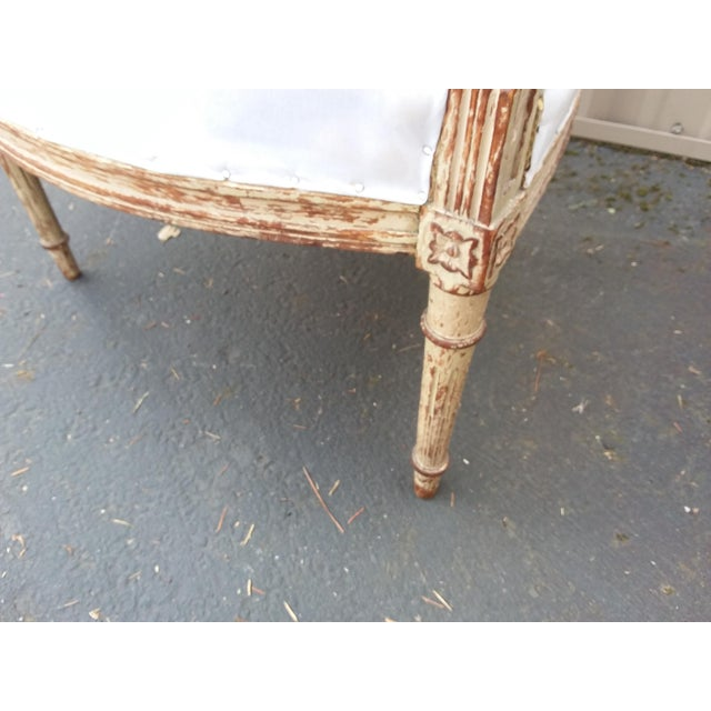 Beautiful antique 18th century French armchair with carved top and original paint.