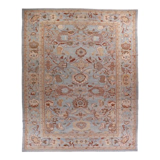 Large Persian Oushak Style Rug With Beige & Brown Floral Patterns on Blue Field For Sale