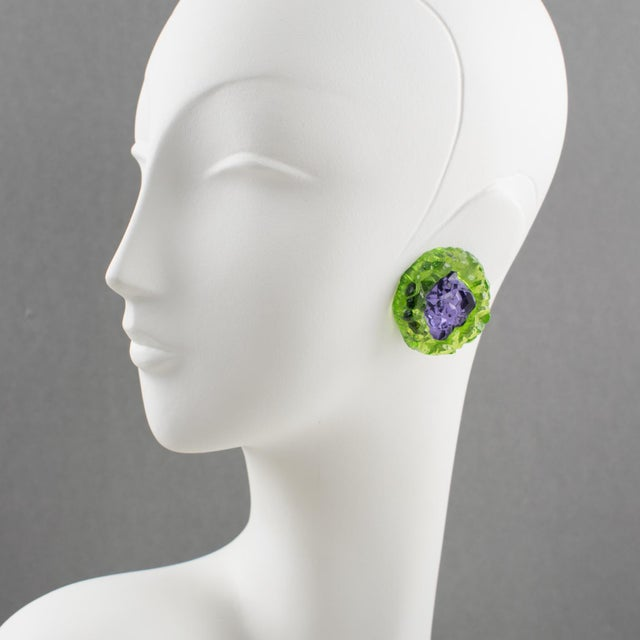 Impressive oversized carved Lucite clip on earrings from Italian Designer Studio. Dimensional rounded shape with rock...