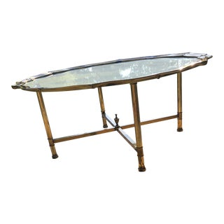 Hollywood Regency Glass Coffee Table W Scalloped Edge and Brass Legs For Sale