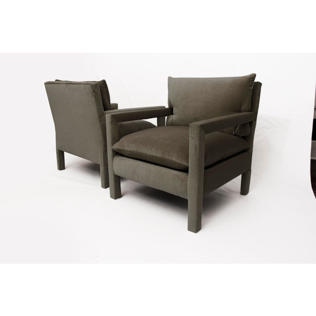 Stunning pair of 1970s style Parson Lounge Chairs attributed to Milo Baughman. The pair has been newly upholstered in an...