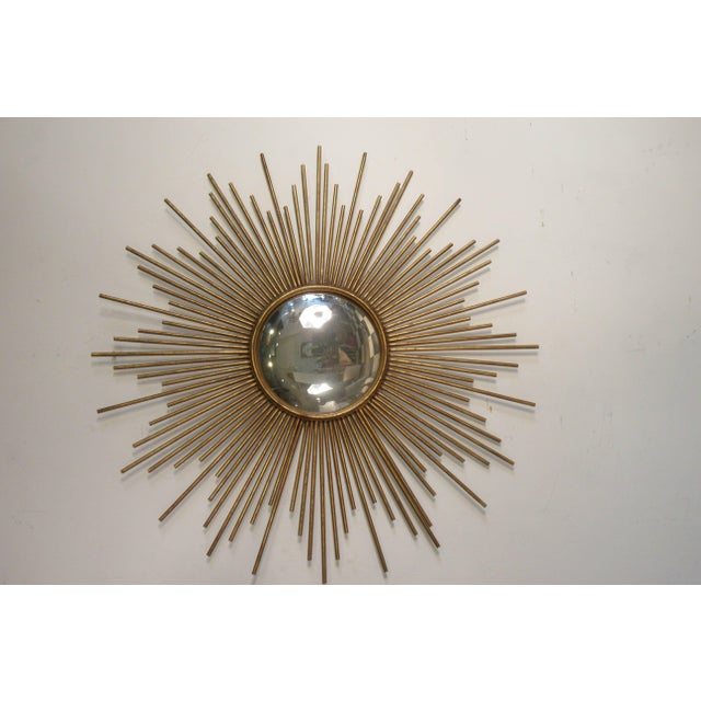 Sunburst metal convex mirror. There are about four available.