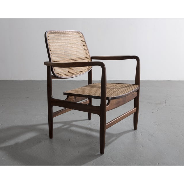 """Poltrona Oscar"" chair in solid wood with cane seat and back. Designed by Sergio Rodrigues, Brazil, 1958."
