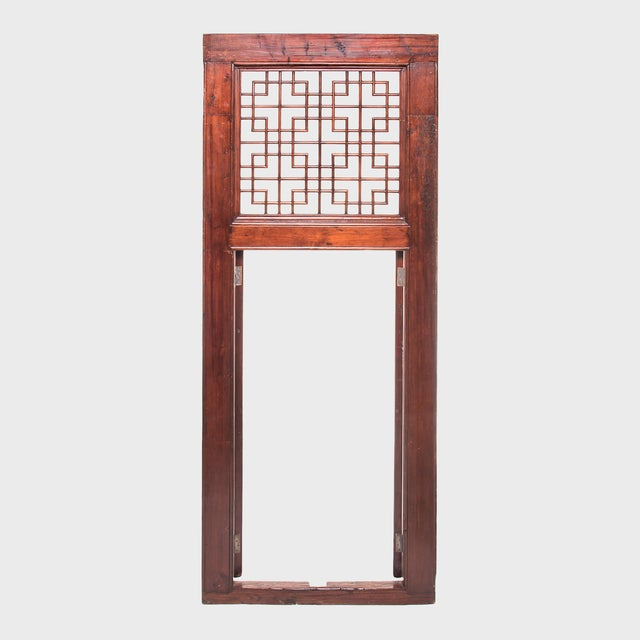A hallmark of Qing-dynasty domestic architecture, hand-carved lattice doors such as this one were used in provincial...