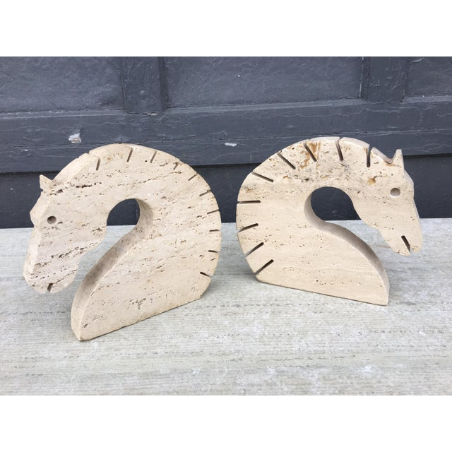Nice pair of travertine marble horse head bookends. Whimsical heads with cut out areas for the mane and eyes. Very...