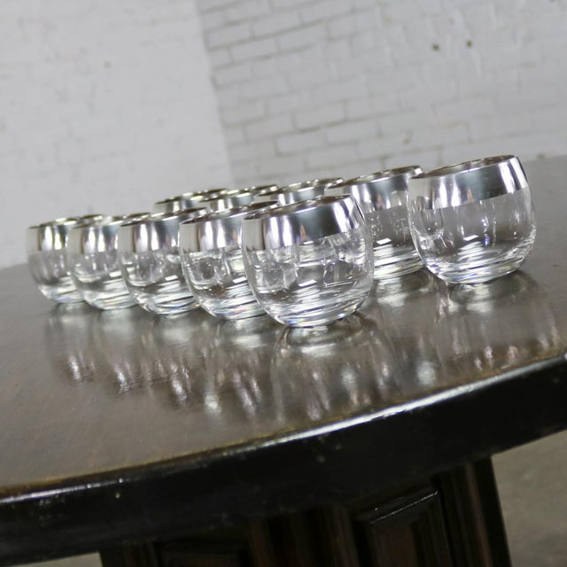 Stunning set of ten sterling silver rimmed roly poly cocktail glasses attributed to Dorothy Thorpe. They are in wonderful...