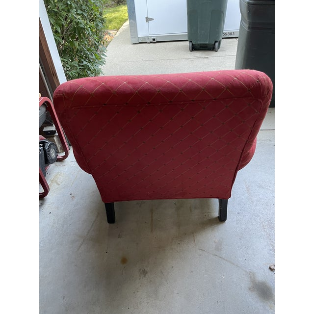 Red upholstered chair with gold in it. Purchases in 1985 from Steve Chase Associates in California