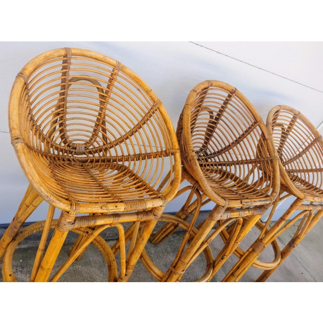 Set of 3 mid century modern Franco Albini style rattan bar stools. Fabulous round sculptural lines. From the 1950's, these...