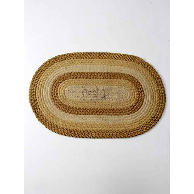 This is a vintage braided accent rug. The classic rustic country rug features multi tones of brown and cream wool in a...