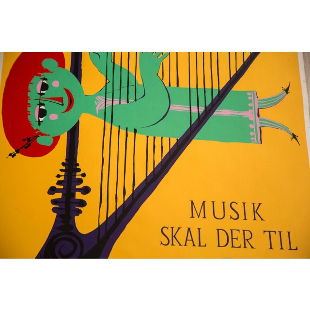 Perhaps one of Wiinblad's most famous posters - a green guy almost a part of the harp and playing it. Modernist art, this...