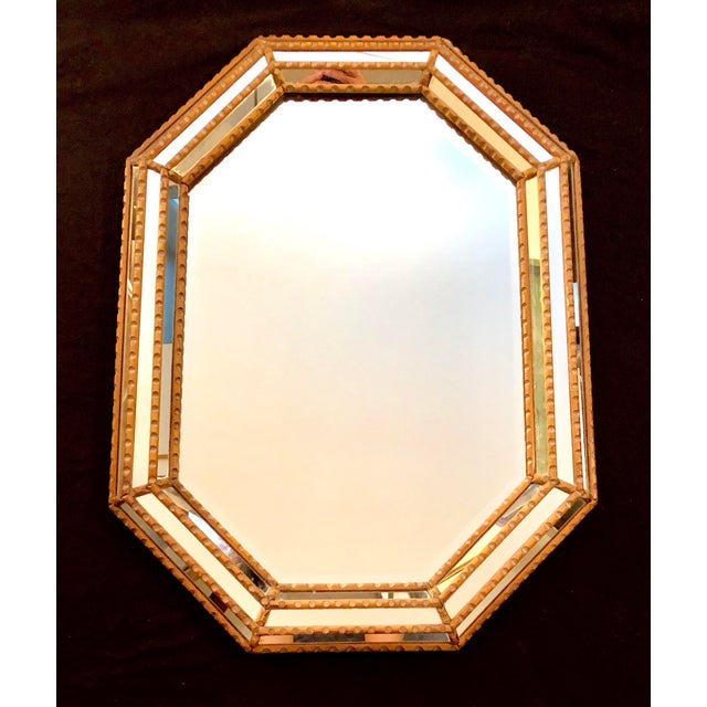 This is a fabulous vintage Italian mirror with a beveled & beaded sectional mirror frame. The piece shows wonderful age...