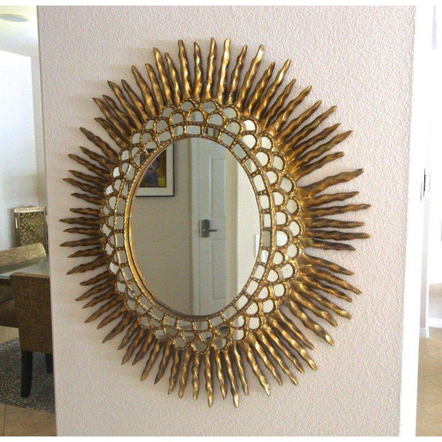 Mediterranean 1970s Spanish Colonial Sunburst Oval Giltwood Wall Mirror For Sale - Image 3 of 11