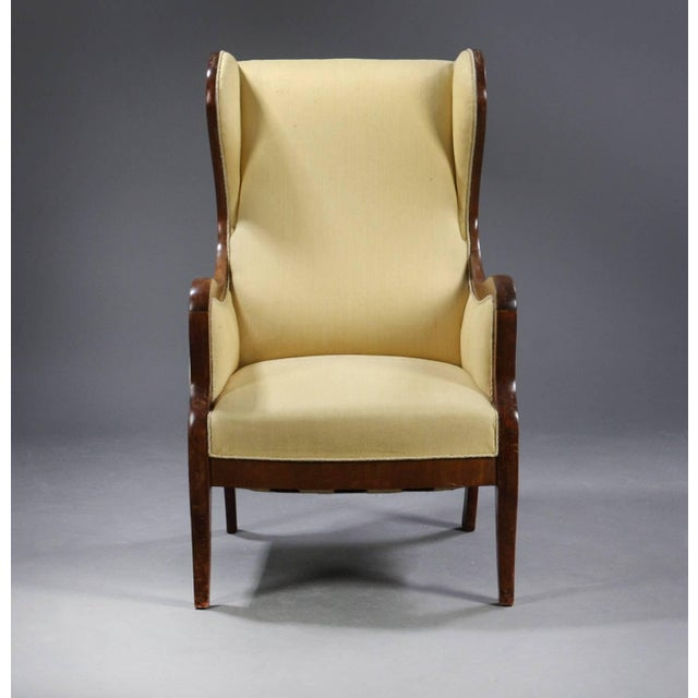 Beautiful classic 1930s-1940s solid mahogany wingback chair produced by Master Cabinetmaker Frits Henningsen, Denmark....