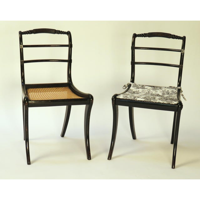 A pair of 19th Century English Regency Period ebonized side chairs. Period: 19th Century Region: England Materials:...