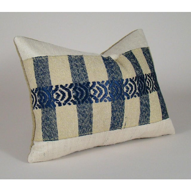This unique limited-edition pillow cover features a vintage Japanese sakiori obi, handwoven from shredded silk garments...