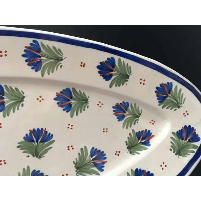 """Large 21"""" French Quimper oval platter decorated with a deep blue and green floral pattern signed HR Quimper (Henriot..."""