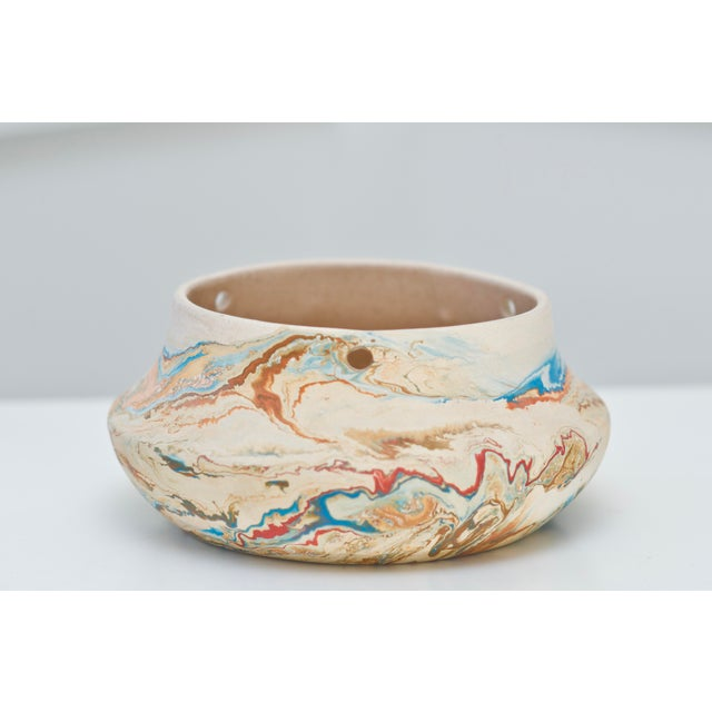 This is a rare Nemadji Pottery hanging planter in beautiful condition. The blue, orange, red and rust swirls blend to make...