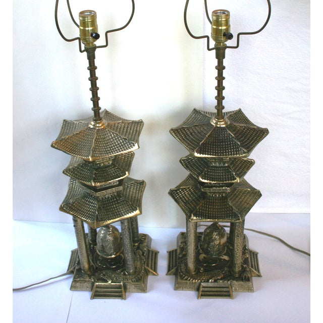 An amazing pair of vintage brass multi-tiered padoga lamps. A rare find; it's especially exciting to find a pair! Three-...