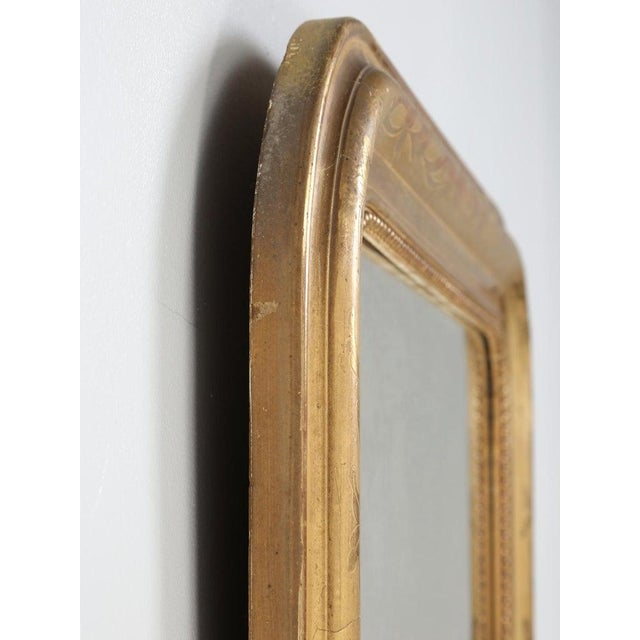 Antique French Louis Philippe style mirror, that amazingly, has avoided any amateur restoration. Generally, anytime we...