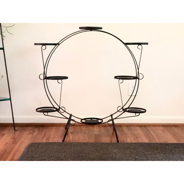 Calling all plant lovers! This is an early 20th Century Art Deco plant stand that is made of iron and is round in shape....
