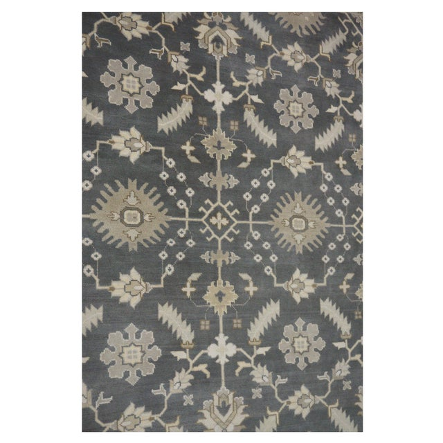 This beautiful Oushak rug is hand-knotted with 100% wool, and made in India. It features an all over pattern in a...
