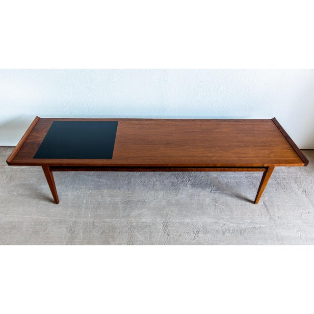 PRODUCT DETAILS: Mid-Century Modern coffee table by Dillingham from the esprit collection. Features: Top has bat-ear tips...