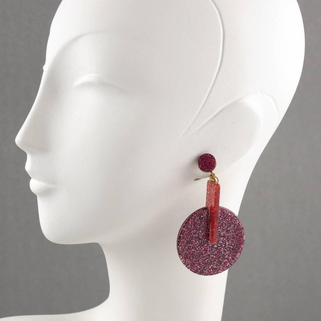 Italian oversized Lucite clip on earrings. Featuring dangling geometric shape, with glitter flakes inclusions. Assorted...