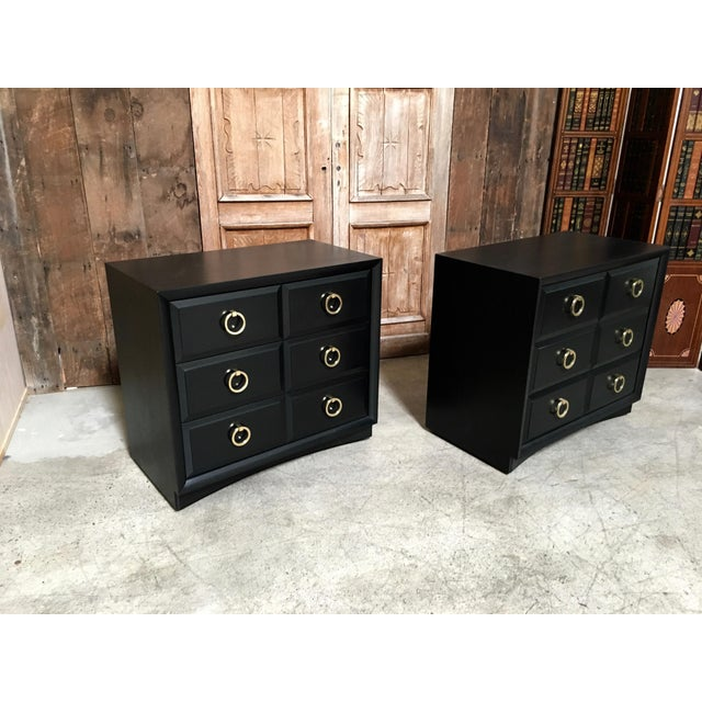 Pair of Classic chest by Robsjohn-Gibbings for Widdicomb. Iconic brass ring pulls. Ebonized wood finish.