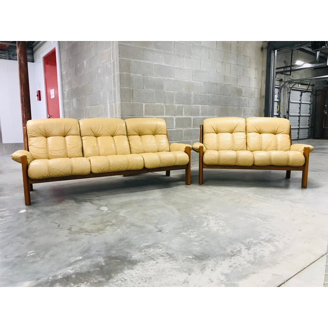 This distressed light tan leather Montana Stressless Sofa and Loveseat by Ekornes is a masterful balance of comfort and...