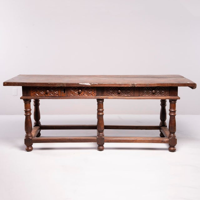 Circa 1780s large, six-legged all-original carved walnut Portuguese table features turned legs with sturdy stretcher,...