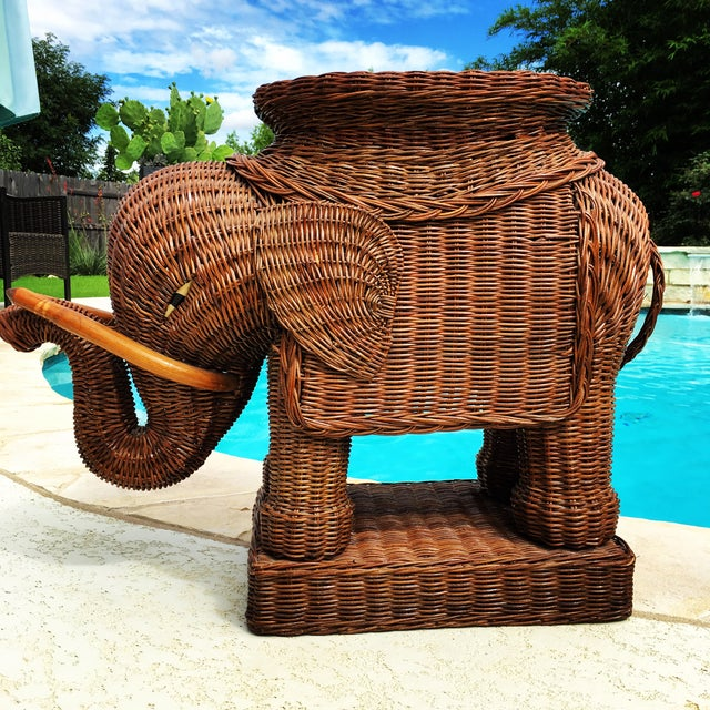 "Beautiful vintage wicker cane rattan elephant table. Measures 26"" long, 20"" tall and 11"" wide in excellent condition with..."