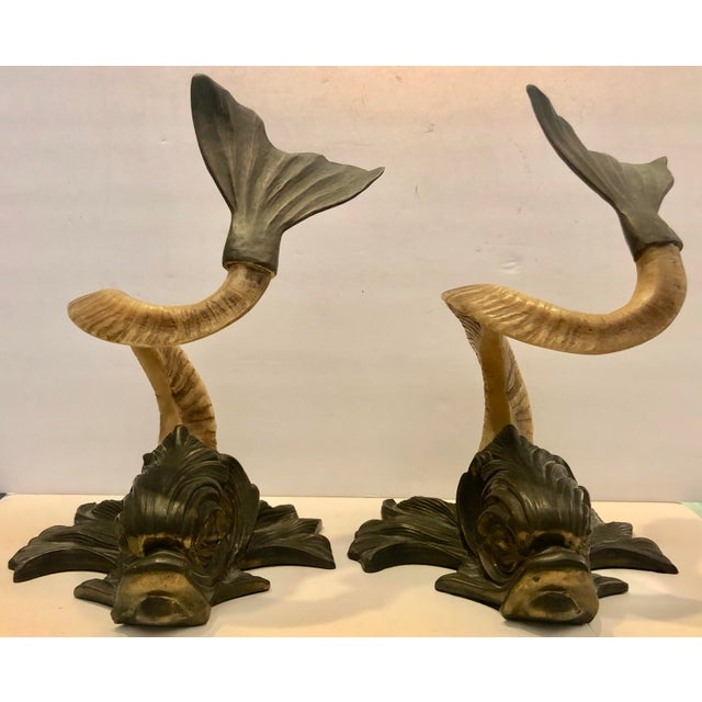 Stunning vintage pair of Chapman fishes sculptures. Baroque style. Made out of resin faux horns with brass tails and heads...