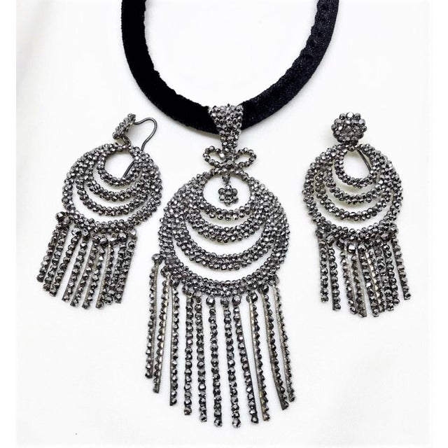 Circa 1800s Georgian cut steel pendant and earrings made up of multi-faceted cut steel beads individually riveted onto the...