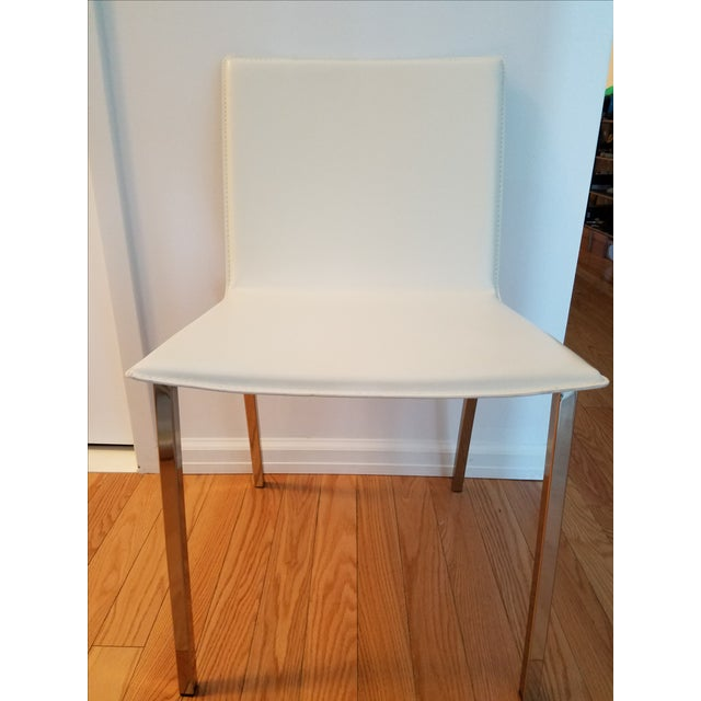 Wide seat. comfortable seating. Bought from CB2 and selling the chair as I am moving.