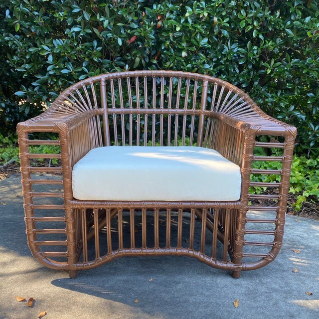 Famed Henry Olko style natural rattan chair with seat cushion. Very comfortable and sturdy structure. Indoor and covered...