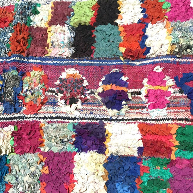 This Boucherouite rug is a genuine article produced by women in the areas around Marrakech and in the Atlas Mountains....