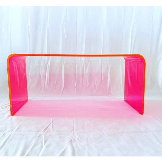 This gorgeous specimen is one in our new line of Memphis Group inspired Neon acrylic tables. Our acrylic coffee table is...