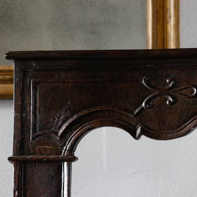 18th Century French Carved Mantle. A stylish carved mantle, light in weight and abundant in appearance.
