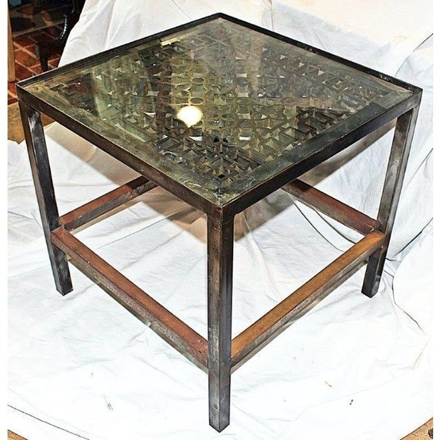 Natural polished cast steel Moroccan-style decorative grid set in a custom made steel table frame and new beveled glass...
