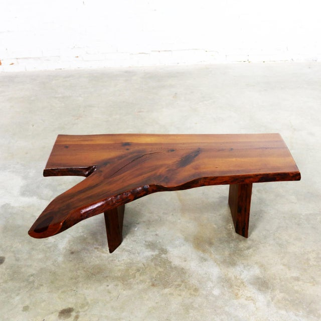 Incredible mid-century live edge or free edge solid slab coffee table or bench in the style of George Nakashima. It is in...